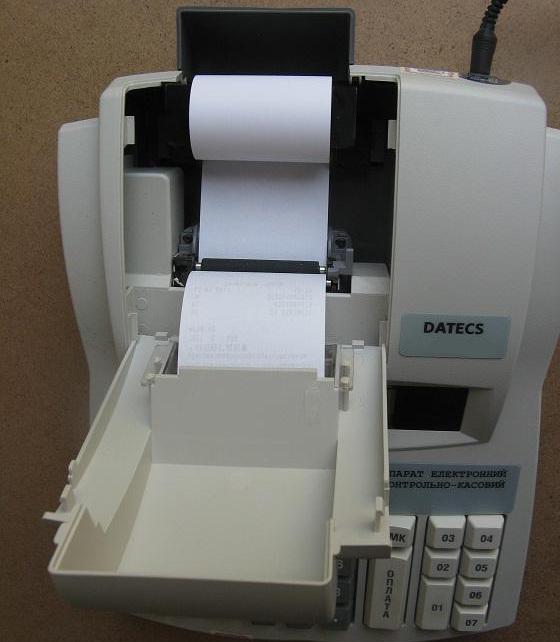 Заправка ленты в кассовый аппарат